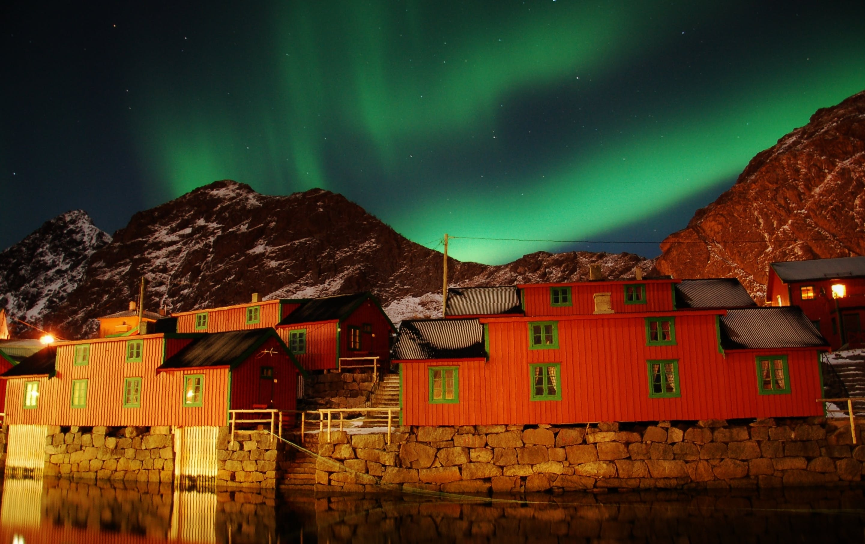 Aurora Borealis dancing over rorbuer in Stamsund, Lofoten Islands - by Carina Hansen.